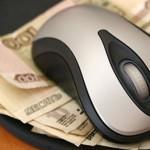 Изображение мышки для компьютера, которая лежит на деньгах